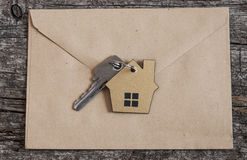 Symbol of the house with silver key Royalty Free Stock Photos