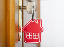 Symbol of the house and stick the key Royalty Free Stock Image