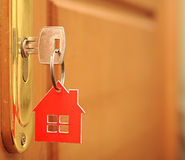 Symbol of the house and stick the key Royalty Free Stock Photos