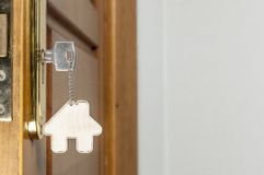House key with silver chrome pendant with home shape Stock Images