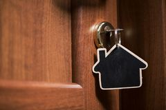 Symbol of the house and stick the key in the keyhole. On a close door Royalty Free Stock Photos