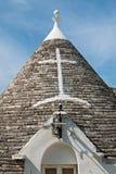 Symbol i Trullo det koniska taket i Alberobello, Apulia, Ita Arkivfoto