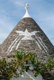Symbol i Trullo det koniska taket i Alberobello, Puglia, Ita Arkivfoton
