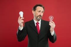 Symbol of idea progress and innovation. Idea for business. Environment friendly idea. Genius idea. Light up your. Business. Man bearded businessman formal suit stock photos