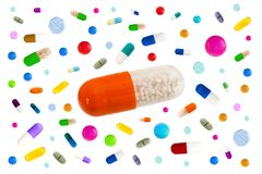 Symbol image of drugs danger : Many colorful medicines Pills and capsules with in the middle a big one on white. Many colorful medicines. Pills and capsules on Royalty Free Stock Image