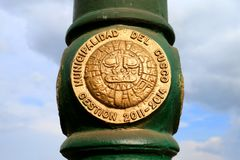 Symbol of the Inca Sun God on the Street Lamp against Cloudy Sky in Cusco, Peru, South America. UNESCO World Heritage City royalty free stock photography