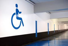 Handicap symbol painted on an underground parking wall royalty free illustration