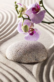 Symbol of inner beauty with orchids and pebble Royalty Free Stock Photography