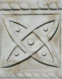 Symbol innerhalb eines keltischen Finanzanzeigekreuzes Stockbild
