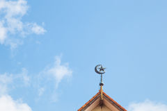 Symbol of Islam. On the roof at the rear of the sky and clouds in the afternoon Stock Photos