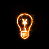 Symbol of Japanese currency Yen inside a sparkling bulb Stock Images