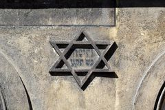 Symbol of jewish star of david on the front on old building in kazimierz-district of krakow in poland. Symbol of jewish star of david on the front on old stock images