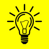 Symbol light bulb. On yellow background Stock Photo