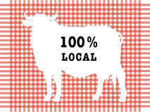 Symbol of local food. Silhouette of a cow with the inscription 100 percent local on a red tablecloth backrgound Royalty Free Illustration