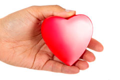 Symbol of love. Giving love - female hand holding red heart Royalty Free Stock Photos