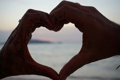 Symbol of love Couple hands making heart shape. stock photography