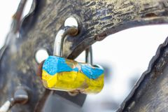 Symbol of love in the form of a lock in the colors of the Ukrainian flag. Lock lovers. A symbol of eternal love, trust and friendship. Valentine`s Day. The Royalty Free Stock Photography