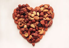 A symbol of love of a handful of nuts. Assorted different types of nuts Royalty Free Stock Image