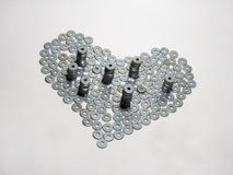 A symbol of love (heart) made of flat washers. Handmade Royalty Free Stock Photography