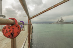 Symbol of love, heart-shaped lock chained on a pier in Novorossi Royalty Free Stock Photo