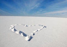 Symbol of love Heart on the snow Royalty Free Stock Photos