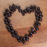 Symbol of love made of coffee. Heart, romantiс and energetic. Royalty Free Stock Images