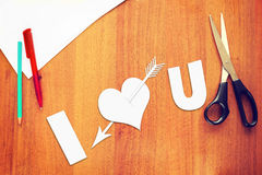 Symbol of love a paper heart pierced by an arrow Royalty Free Stock Image