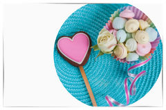 Symbol of love, Pink gingerbread cookie in the shape a heart, sweets, decorated with fresh tender rose on turquoise Stock Images