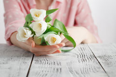 Symbol of love romance, girl has just bestowed a bouquet of white tulips Royalty Free Stock Image