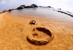 Symbol love on sand Royalty Free Stock Image