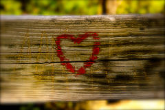 The Symbol of Love. The symbolic drawing of the heart on a wooden rail Stock Images
