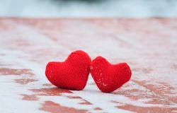 symbol of love two red warm knitted hearts lie together on a royalty free stock photos