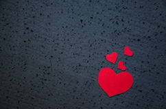 Symbol of love and valentines day background - bright red hearts on a black background. Love concept Stock Photos