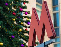 The symbol M-metro. Against the background of spruce Stock Images