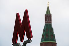 The symbol M-metro. Against the background of the Kremlin Stock Images