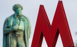 The symbol M-metro. Against the background of Pushkin monument Stock Photography