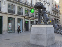 Symbol of Madrid - Bronze Bear. Madrid - October 7, 2015: bronze sculpture - symbol of Madrid - bear fruit for the trailing arbutus in Puerta early morning Royalty Free Stock Photography