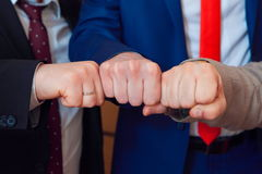 Symbol of male friendship and team. Fists group of businesspeople Stock Photo