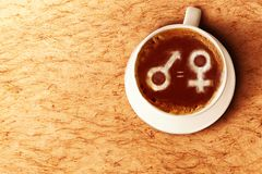 Symbol of male gender is equal to female in the coffee cup. Equality gender concept stock image