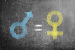 Symbol of male gender is equal to female gender on black wall. Concept of gender equality royalty free stock image