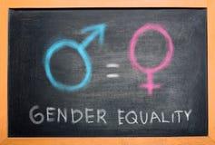 Symbol of male gender is equal to female gender on the blackboard. Equality gender concept stock photo