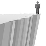 Symbol man at risk to fall off danger cliff edge Royalty Free Stock Photos