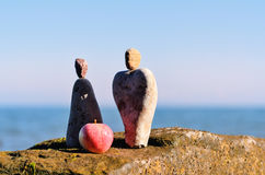 Symbol of man and woman. Figurines of man and woman of the stones at the sea Stock Photos