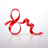 Symbol March 8 of Red Satin Ribbon. On a light background Stock Image