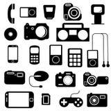 Symbol med elektroniska grejer. Arkivfoto