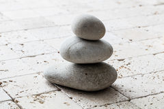 Symbol of mindfulness, balance and meditation over limestone, copy space. Symbol of mindfulness, balance and meditation with stack of balancing pebbles or stones Stock Photos