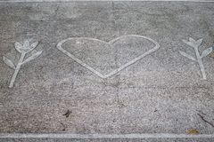 A symbol of Nature Love on a pavement in a park. royalty free stock photos