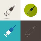 Symbol of needle and syringe for vaccination. Royalty Free Stock Photos