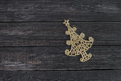 The symbol of new year in the form  Christmas tree on wooden background. The symbol of new year in the form of Christmas tree on wooden background Stock Images