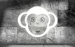 Symbol of 2016 new year monkey face. Ape as symbol of year on concrete wall Royalty Free Illustration